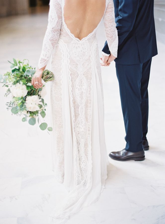Open back crochet lace wedding dress: http://www.stylemepretty.com/california-weddings/san-francisco/2016/07/01/all-the-reason-to-get-married-at-city-hall/ | Photography: Esmeralda Franco - http://esmeraldafranco.com/