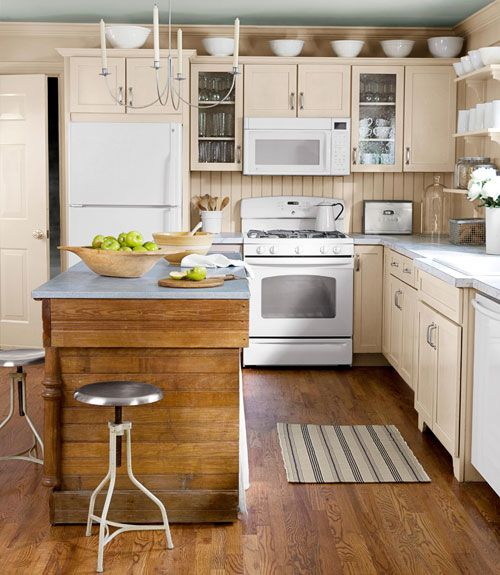 vintage white cabinets, well kinda. They are more beige. Either way.. it looks good with white stove/fridge/microwave