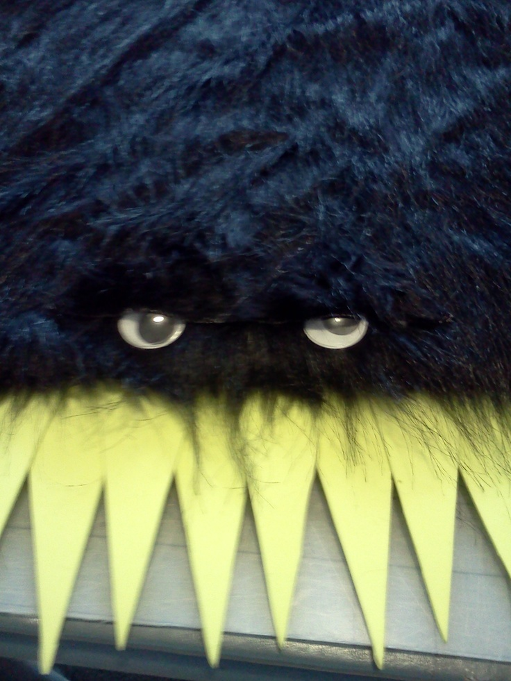 binder covered in fake fur to make a monster book of monsters.  googly eyes, fake fur eyebrows and yellow craft foam teeth