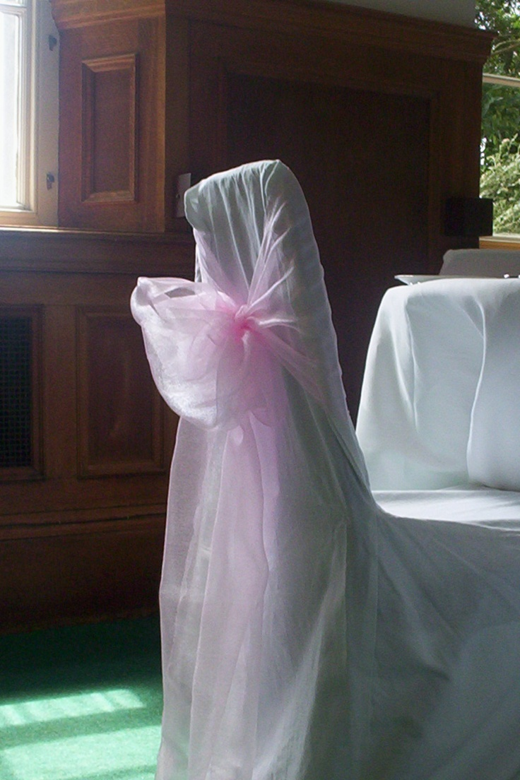 Baby Pink Organza Bows on White Chair Covers
