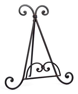 The beautiful scrolling metalwork on this easel stand lends an air of elegance to the study. Placed on the mantel, it's a refined way display a favorite first edition or petite work of art.
