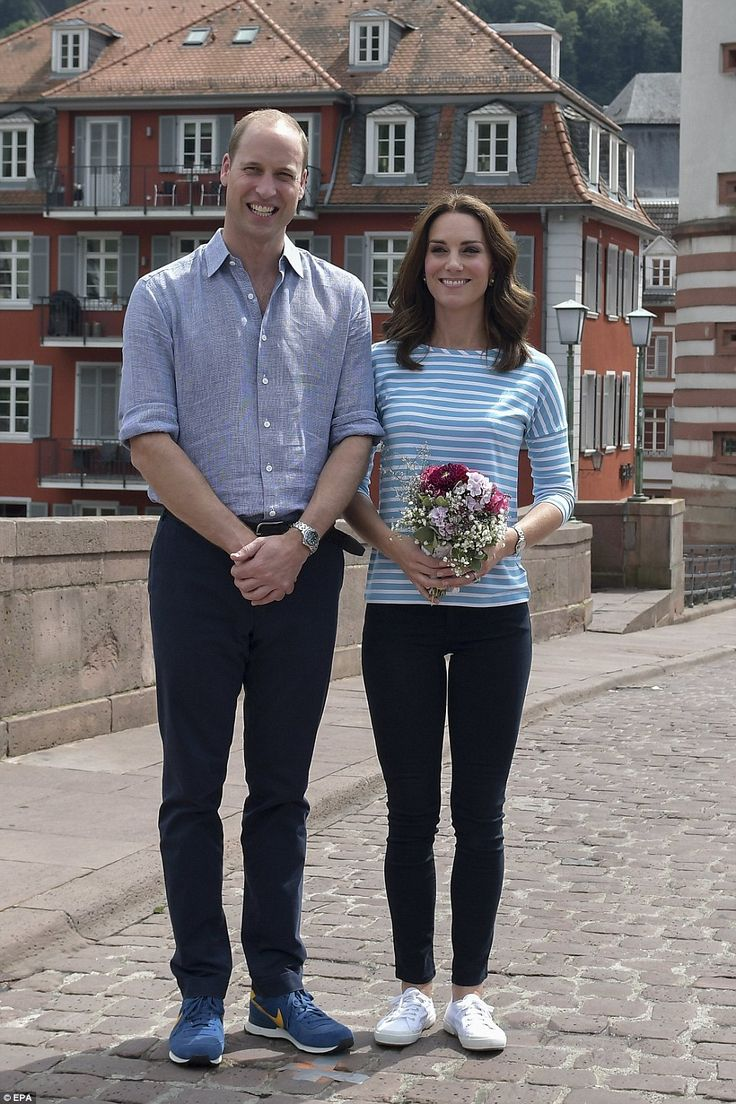 No hard feelings! Kate and William pose for a photo after the Duchess' team was beaten by her husband's, despite having an Olympic rower on her side. The Duchess turned once again to her trusty £55 Superga trainers