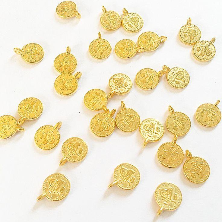 Gouden DQ munt bedel