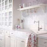AKURUM kitchen with RAMSJÖ white doors/drawers/glass-doors, PRÄGEL white countertop and FÅGLAVIK black knobs/handles  FÅGLAVIK Handle $7...