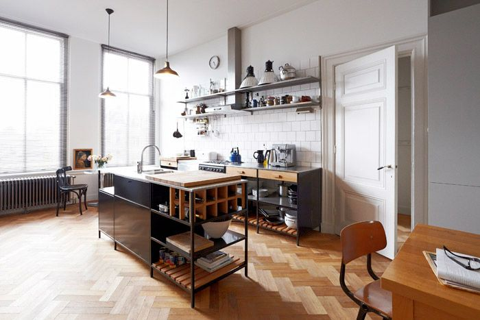 Look at the floor, door and open shelving amidst all that light and the simple tile backsplash. Brilliant.