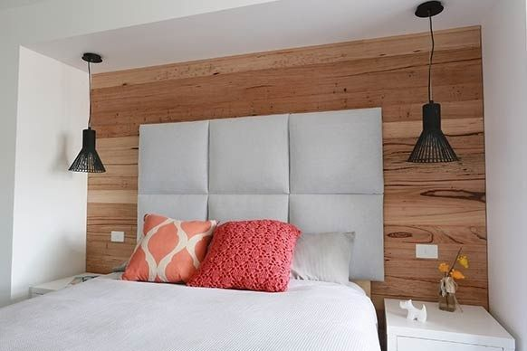 Timber feature wall... Love the bedside hanging lamps