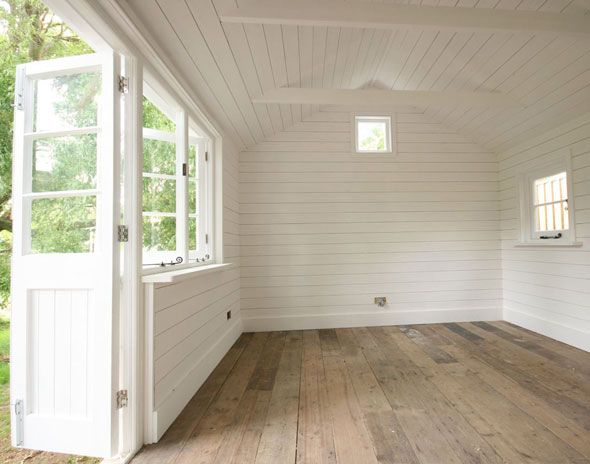 love the time worn floor with fresh, clean white walls, and lots of windows