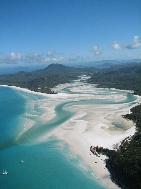 Whitehaven Beach, Queensland, Australia. A 7 km stretch along Whitsunday Island. The island is accessible by boat from the mainland ports of Airlie Beach and Shute Harbour, as well as Hamilton Island.