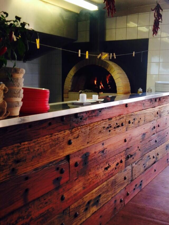 Outdoor kitchen. Wood fired oven, wood grill