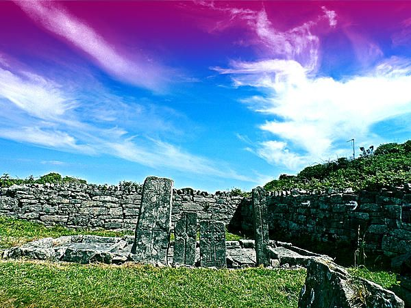 "'Old Irish Stones' - photograph by Alan Hogan. Photograph from an old monastic site in Ireland called Na Seacht dTeampaill, or the Seven Churches. It's on the island of Inis Mor (Aran Islands) off the west coast where I saw these gravestones. inscribed as being of the ""Seven Romans"".  'Got some amazing weather too! It's all on my blog with a few more photos here: http://alanhogan-artgarage.blogspot.fi/2013/09/on-edge.html   Facebook page -https://www.facebook.com/hoganfinland"