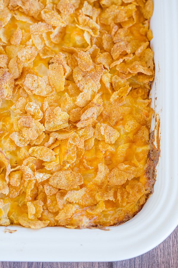 This easy Potato Casserole is creamy, cheesy and topped with crunchy Corn Flakes. | Brown Eyed Baker