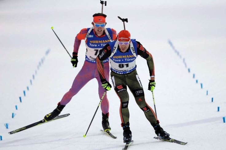 Germany's Arnd Peiffer competes on the finish line in front of Sean Doherty of the U.S. during the m... - Matthias Schrader/AP Photo