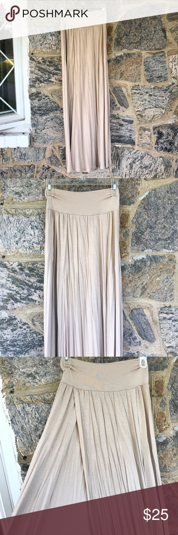 Tan Maxi Skirt with Double Slit Tan Maxi Skirt with Double Slit. Cotton Material. Never worn! Perfect Condition! Great for Summer!! 🌞🌊 Skirts Maxi