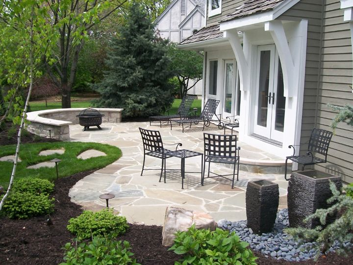 flagstone patio and simple garden - Stone Patio Designs