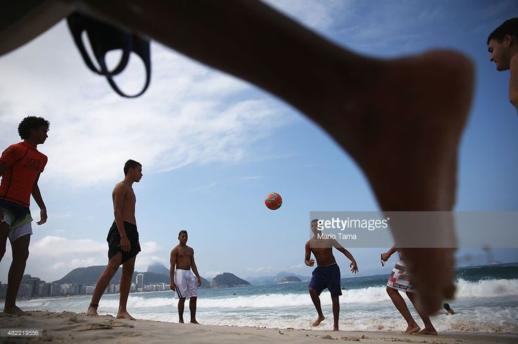 Brazilians play soccer on Copacabana beach on July 28, 2015 in Rio de Janeiro, Brazil. The famed beach will host various Olympic events including beach volleyball, cycling, open water marathon and triathlon. August 5 marks the one-year mark to the start of the Rio 2016 Olympic Games.