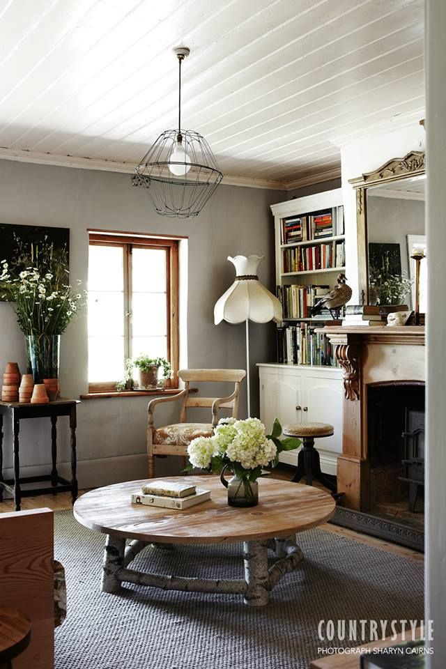 Country Style magazine. At this mid 19th-century cottage in at Woodside, South Australia, the light and the landscape provided inspiration for the owners, an artist and a furniture designer. Photography Sharyn Cairns, styling Indianna Foord #countrystylemag #countrylivingroom #mantlepiece