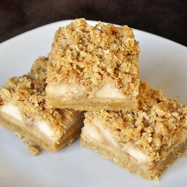Apple Pie Crumble Bars - an incredibly popular cookie bar that can also double as a delicious dessert when served warm out of the oven. A great use for all those Autumn apples::