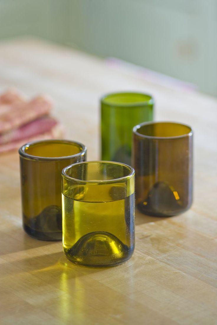 wine bottles cut down as drinking glasses