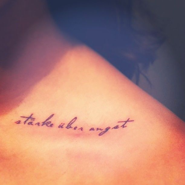 """strength over fear"" in German (my family's language) on my collarbone"