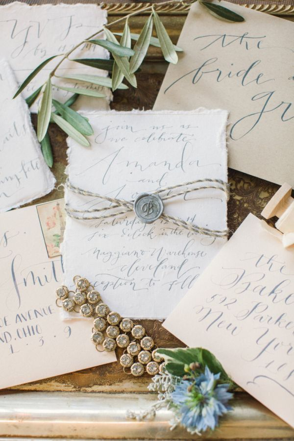Featuring handmade cotton paper with naturally deckled edges, these organic-looking wedding invitations are hand-lettered by calligrapher Danica Butler.