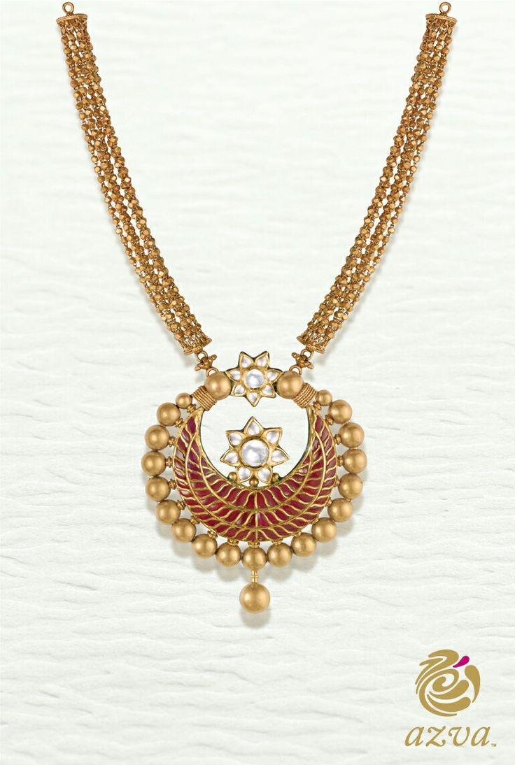 Azva contemporary medallion with red kundan flair. #Goldjewellery #luxury #style