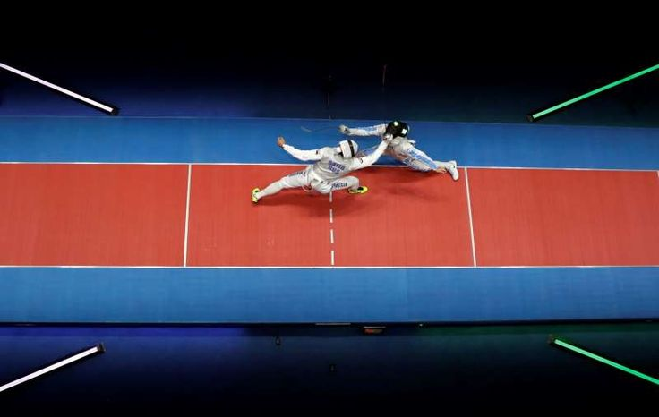 The best sports pictures of 2016:      Davide Garozzo of Italy ﴾R﴿ and Timur Satin of Russia compete in the men's individual foil fencing event at the 2016 Summer Olympics in Rio de Janeiro, Brazil on Aug. 7.