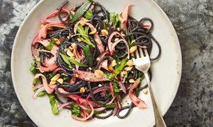 Yotam Ottolenghi's black spaghetti with pickled rhubarb, ginger and peanuts.