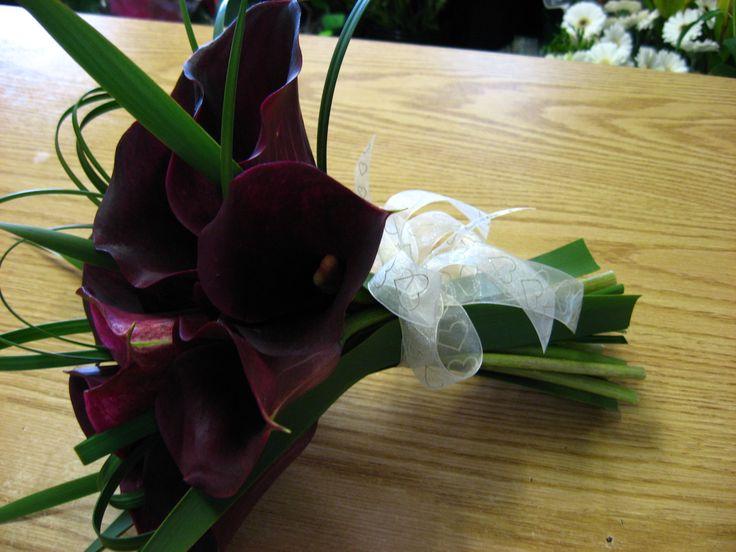 Fresh flower dark burgundy calla lily posy bouquet.