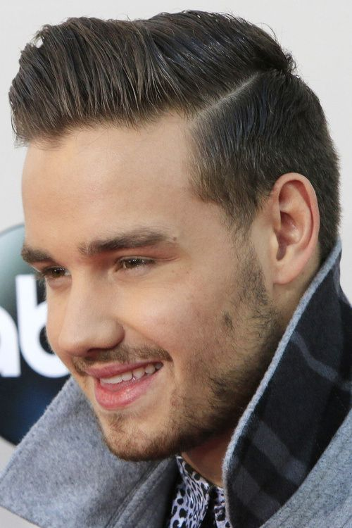 side-parted men's hairstyle with pompadour quiff