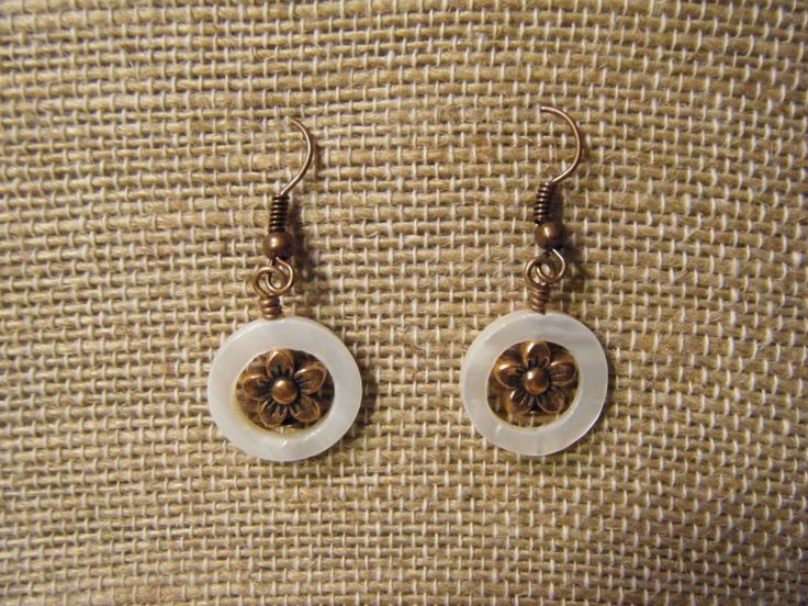 White open circle shell with antique bronze flower.