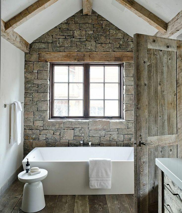 paredes-de-piedra-bano-banera-blanca-estilo-moderno