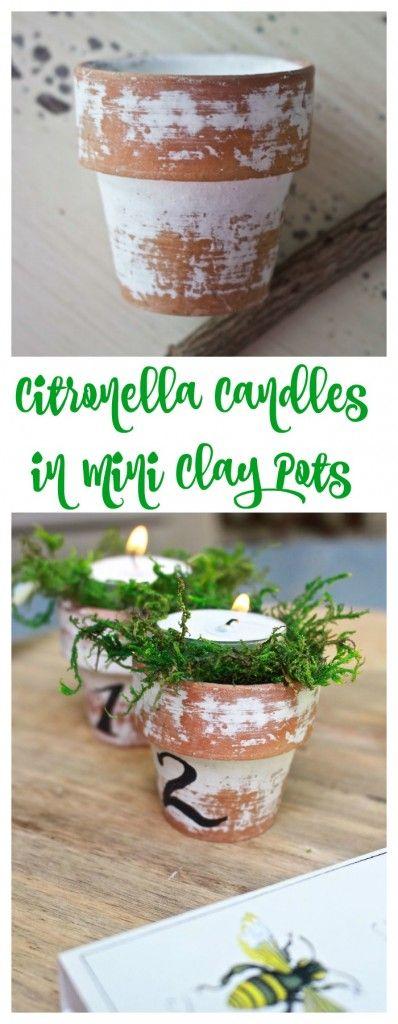 Citronella Candles in Mini Clay Pots. Numbered clay pots. Mini terra cotta pots. Outdoor pots. Keep mosquitoes away with citronella candles. Clay pots. Moss in pots.