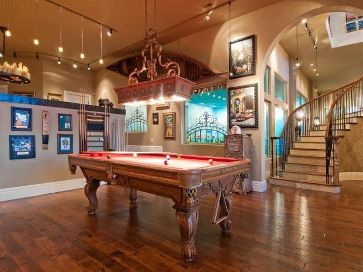 Mediterranean Game Room with Cathedral ceiling, Hardwood floors, Chandelier, Pendant light