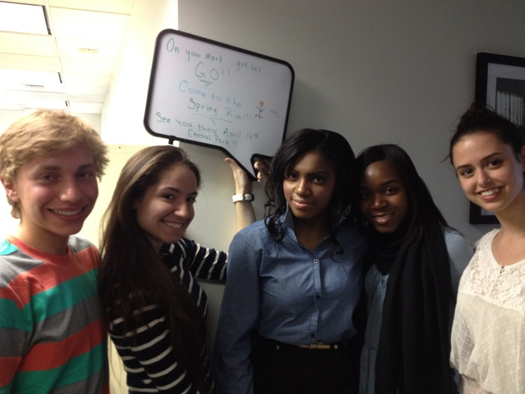 Global Concerns Classrooms Ambassadors and NYC high school students with a message on our Spring Run on 4/14!
