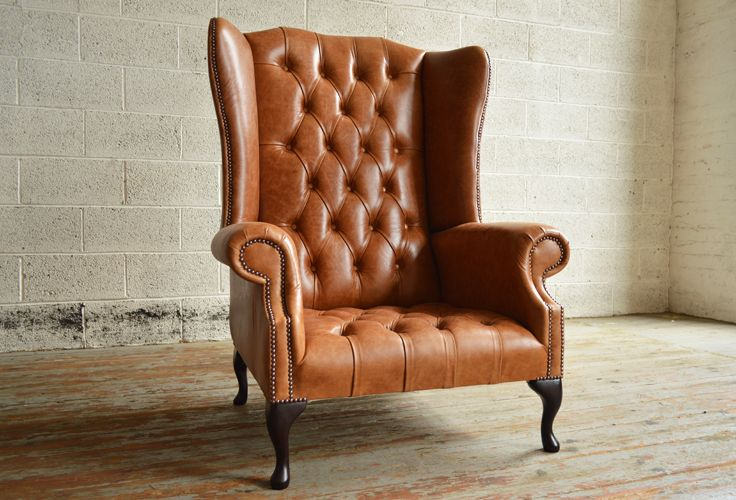 Traditional Vintage British handmade deep buttoned Boss Chesterfield Wing Chair, shown in Old English Tan leather. Large High Back Chair. | Abode Sofas