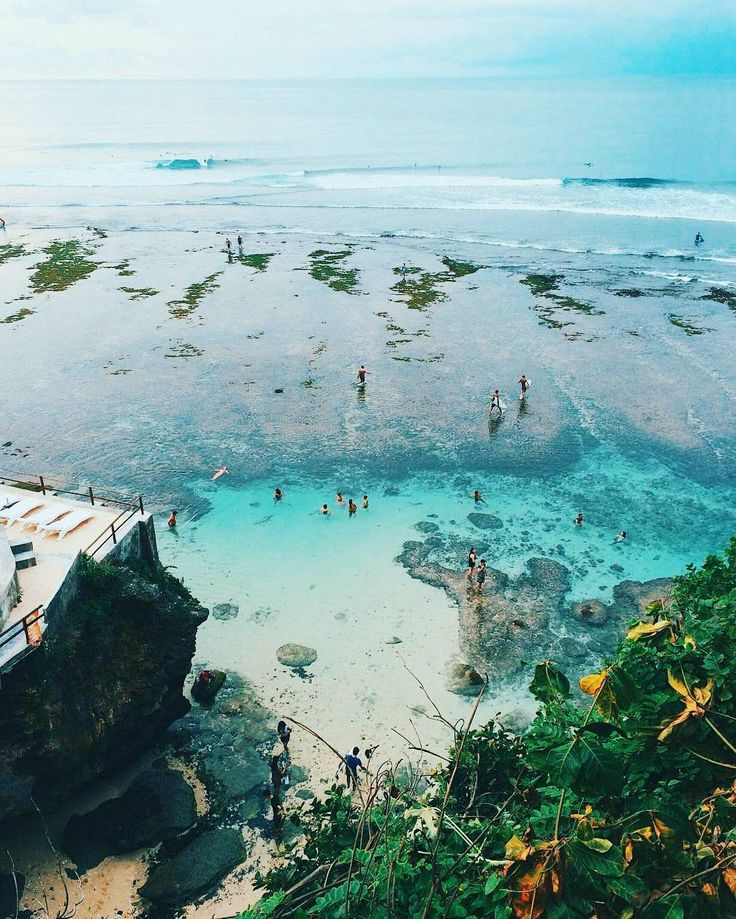 The enchanting Blue Point Beach in Bali.  What is your most favorite beach in the world? .  Photo by @annietarasova |  Tag your travel pics with #postcardandtag #pntDiscover