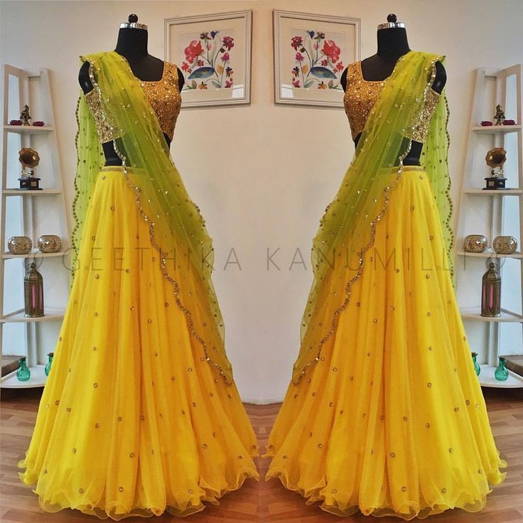 Stunning sunshine yellow color lehenga and crop top with green color net dupatta. Lehnaga and crop top with hand embroidery work. 30 October 2017