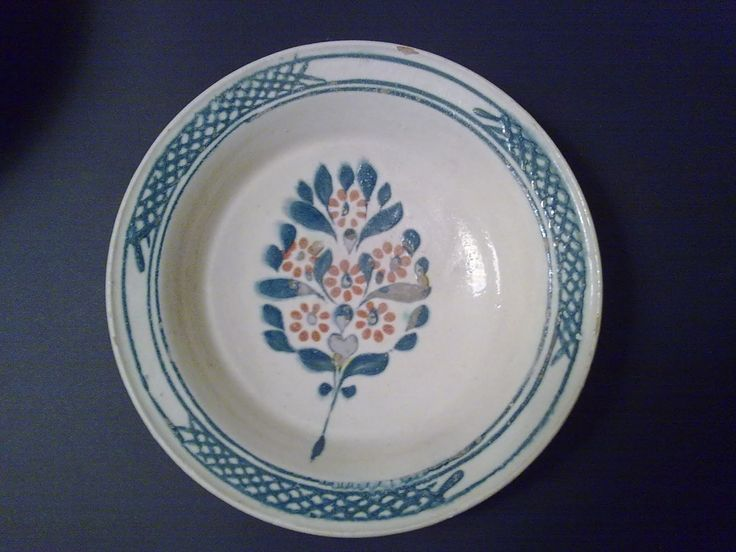 Chanakkale plate,ca 1750.Blue,orange, branch with leaves and flowers,interesting pattern on the perimeter.