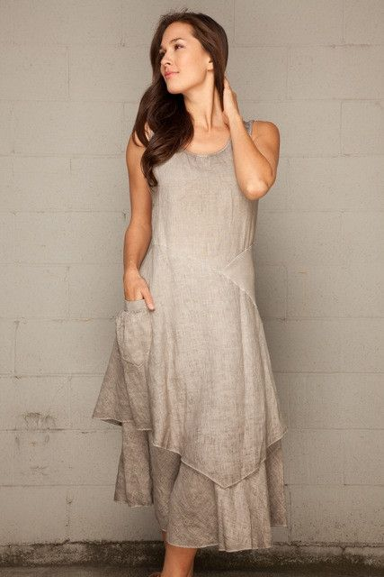"""Italian linen dress is back in your favorite Flutter style by Inizio. This best selling style comes in sleeveless, flowing design, double layer A-line skirt and cotton rib back and waist inset to ensure great fit. Nice deep pocket on a right side. Length is about 46"""" from the high point of shoulder to the bottom. Sizing runs small. Made in Italy."""