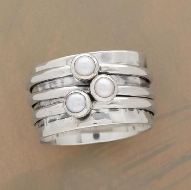 """Three spinning rings with orbiting cultured pearls on a hammered base band. Exclusive. Handcrafted in sterling silver. Whole sizes 5 to 9. 7/16""""W."""