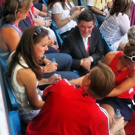 Kate chatting in an image from CTV producer Trish Bradley  while enjoying team GB women's hockey match. 8-11-12