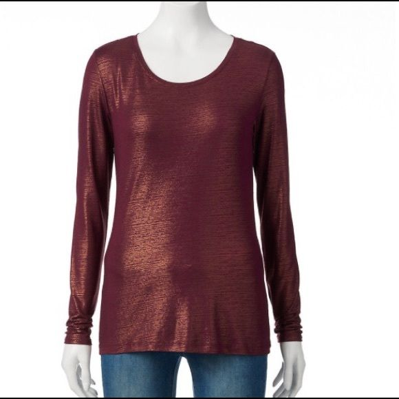 Maroon & gold long sleeve top. Maroon & gold long sleeve top. Metallic sheen. You definitely need this gorgeous crewneck in your everyday wardrobe! Never worn or tried on. No flaws, no rips stains or tears. Size L. Material: 95% rayon, 5% spandex. NWT. Mannequin above is size S. Tops Tees - Long Sleeve