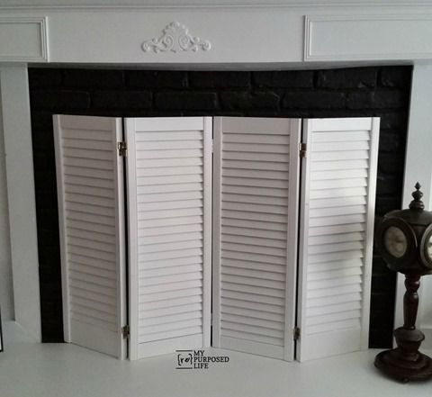 DIY fireplace screen made from repurposed shutters