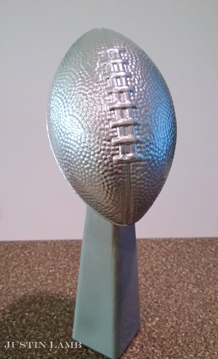 Just finished my DIY Lombardi Trophy for #sb49 party! All you need is a small vase and foam football from the dollar store. super bowl party idea game day centerpiece