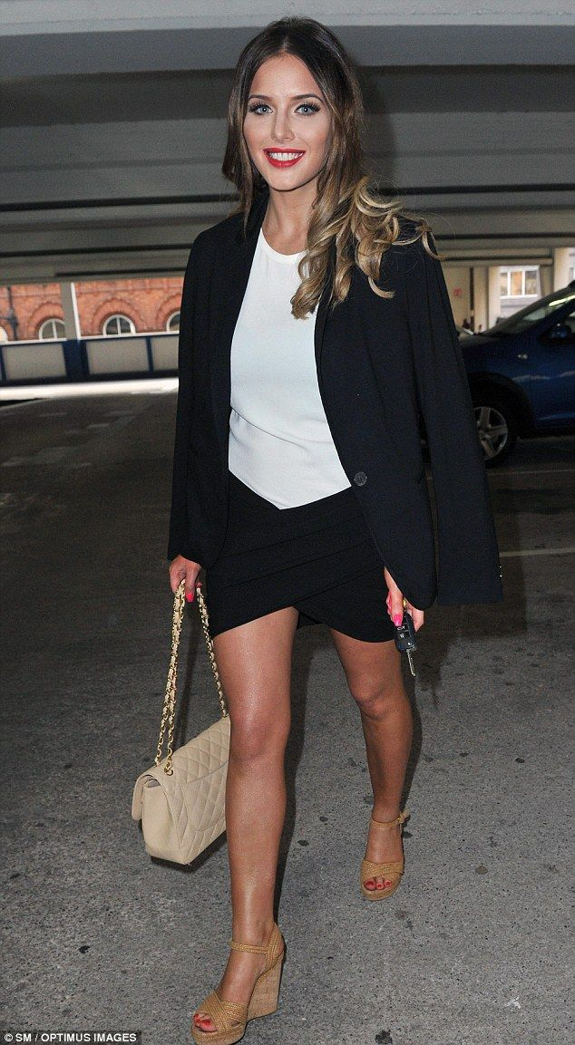 Helen Flanagan puts on a leggy display in a smart black skort suit #dailymail