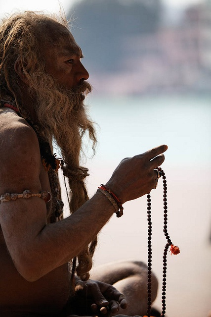 Shiva Raj Giri, Naga baba (naked sadhu) in Haridwar telling mantras with his mala. #Mala has 108 beads.: