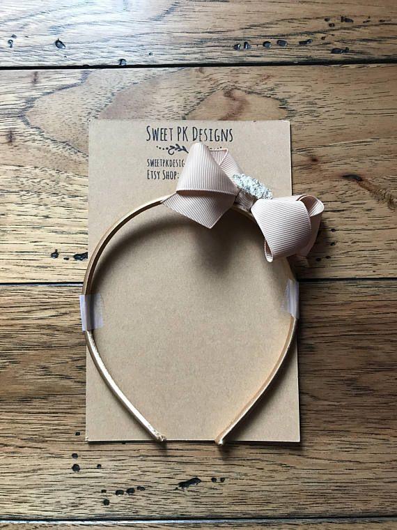 Fancy beige headband with rhinestone