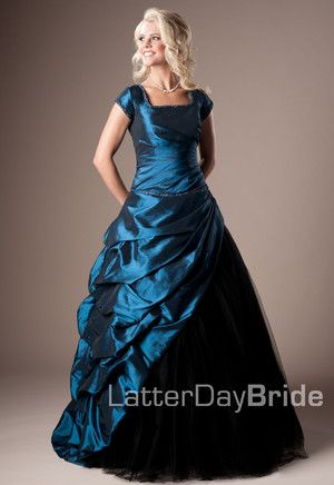 Full taffeta and tulle ball-gown. This gown has an assymetrical taffeta skirt with bustles and tulle underneath. The wrap at the waist makes this one of our most flattering modest prom dresses.