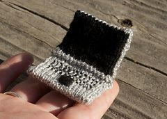 Make this tiny laptop for toys you've made that need to do some computing or for the techie in your life who needs something fuzzy. Techniques include Judy's Magic cast-on, knitting in the round using double-pointed needles, short row shaping, stranded two-color knitting, and a grafted bind-off.