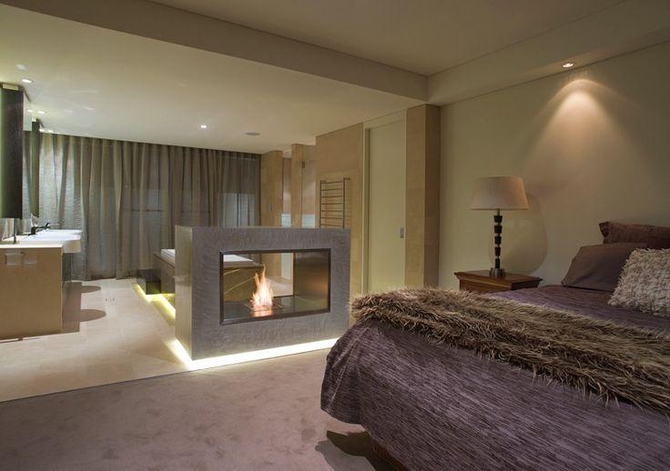 Lighting under bottom edges - EcoSmart Fire 900DB fireplace featured in the Waterman Hotel, Western Australia  https://ecosmartfire.com/product/firebox-900db/